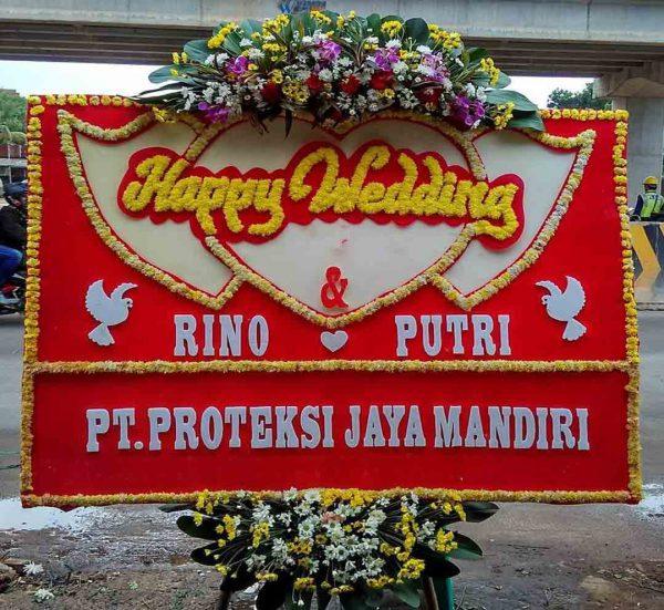 bunga papan happy wedding oleh rino dan putri dari pt proteksi jaya mandiri