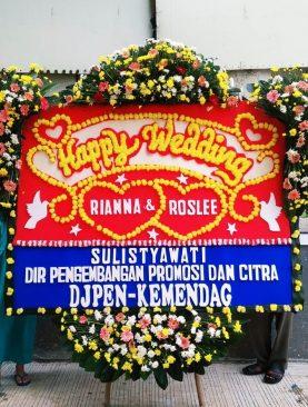 karangan bunga happy wedding dari DJPEN kemendag
